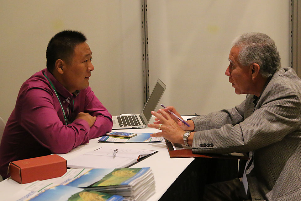 Trade Summit meeting on trade show floor